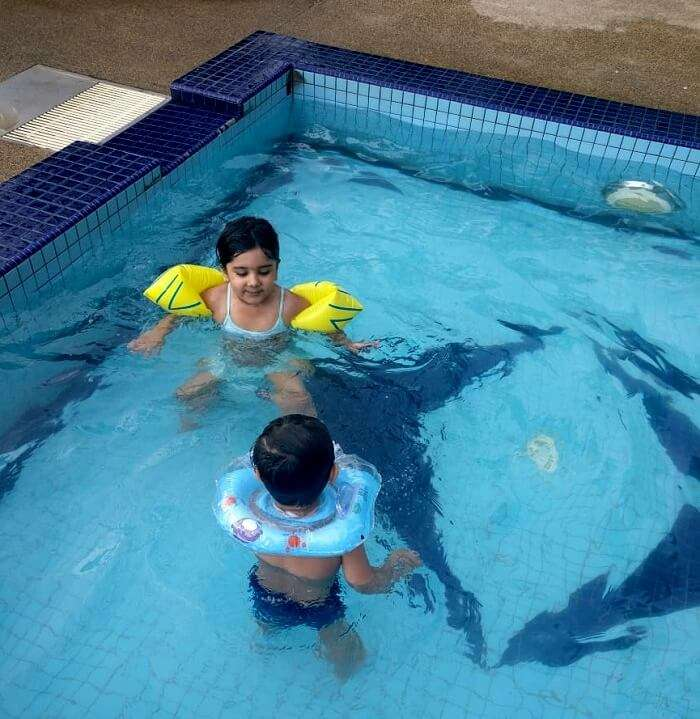 Children playing at hotel pool