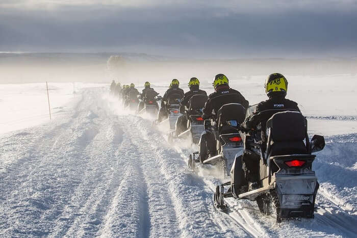 Snowmobiling in snow mountain