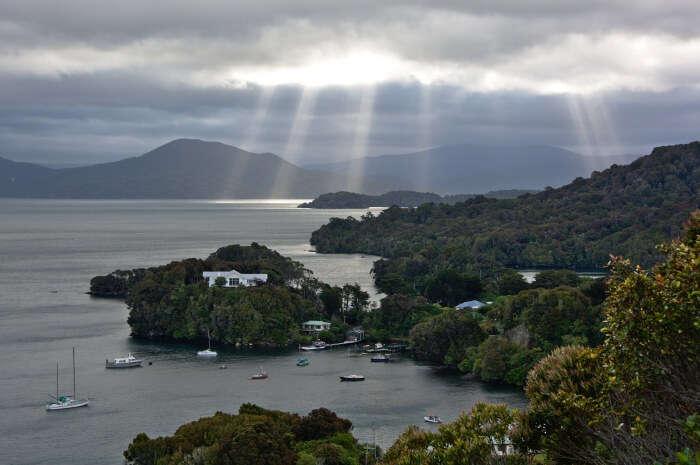 Sunbeams over islands Faith, Hope, and Charity