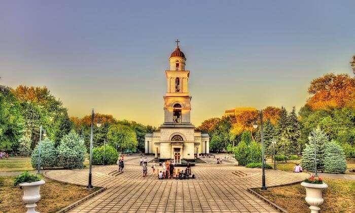 tourist near bell tower in chisinau