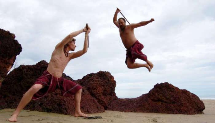 Men performing Kalari