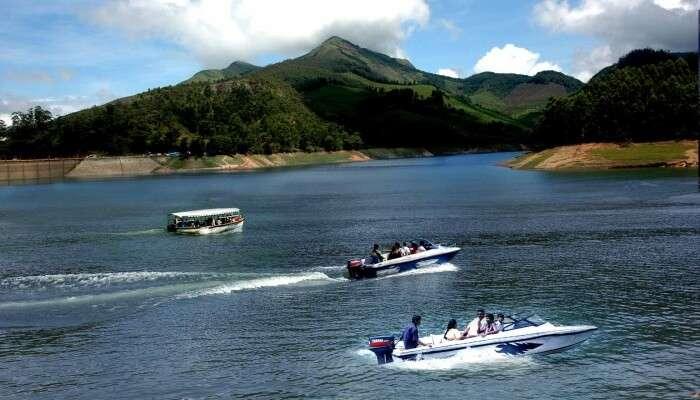 people enjoying motorboat ride on a lake