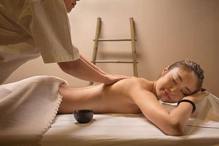 A woman undergoing massage treatment