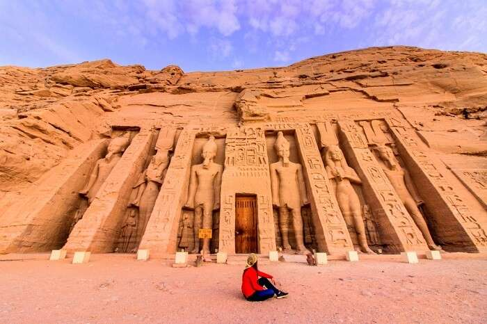 Girl sitting in front of Abu Simbel temples