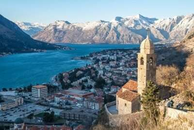 snow capped mountains and city in Montenegro