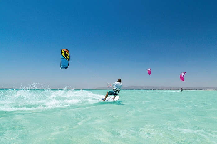 person trying kite surfing