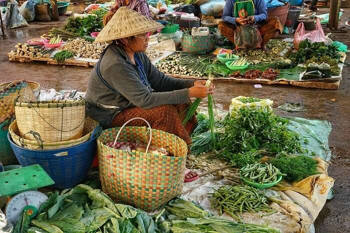 woman sitting with vegetables