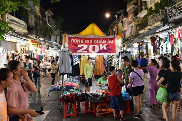 people buying discounted clothes in hanoi