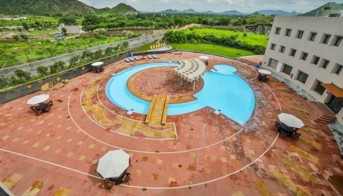 aerial view of a 5-star hotel property with a swimming pool
