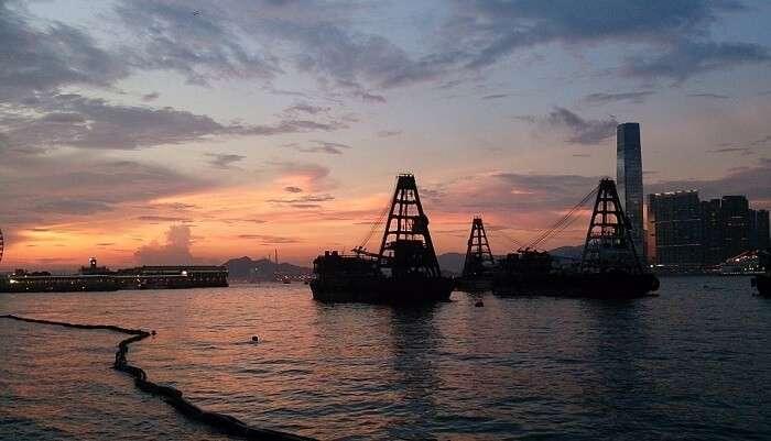 Admire Sunset At Victoria Harbour