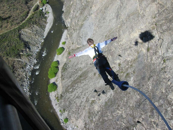 guy jumping from nevi highwire