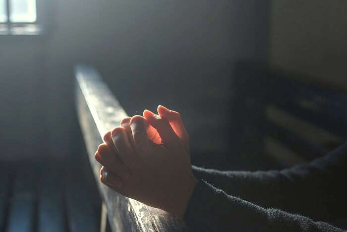 A person praying at the St. John's Anglican Cathedral in Napier