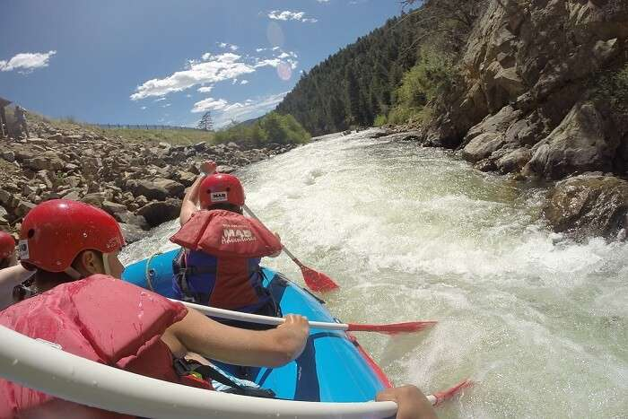 person rafting the boat in speed