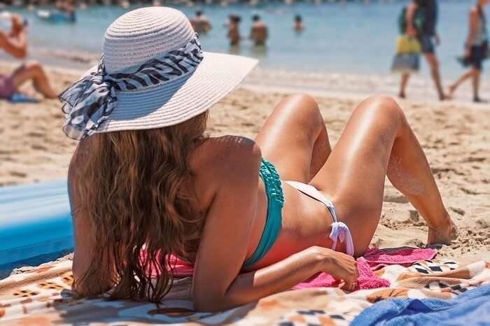 Woman Summer Beach Bikini Exposure To The Sun
