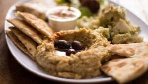 turkish starter served on a plate with dips and garnishing