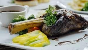 lamb dish on a plate with garnishing