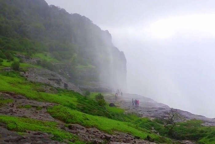 People standing near reverse waterfall