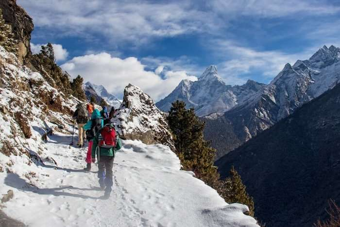 Trekkers climbing the pangarchulla peak