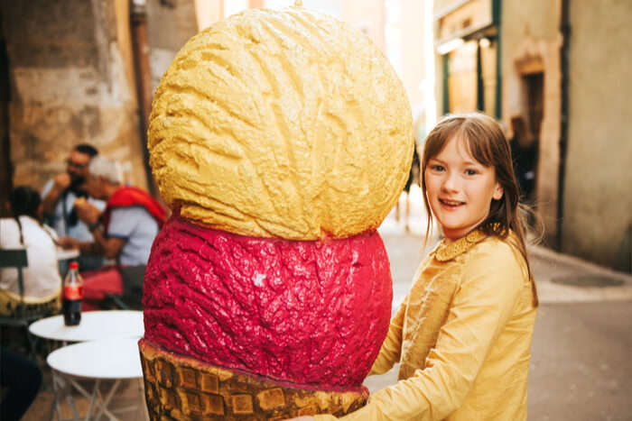 Girl holing the biggest ice cream