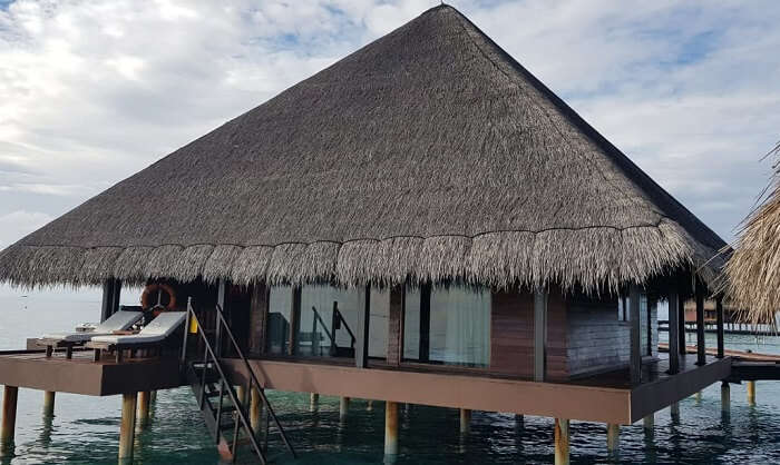 a lavish over-water villa experience