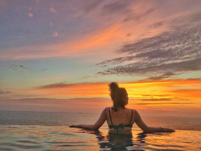 Witnessing the sunset together in the pool