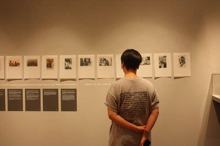Visitor gawking at art