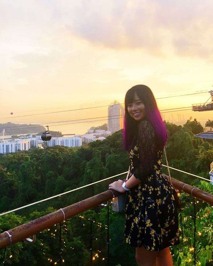 tourist enjoying the sunset view at cable car museum in singapore