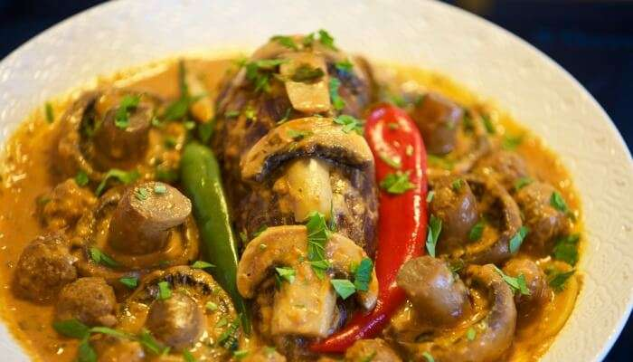 mushroom dish served with chillies as its garnishing