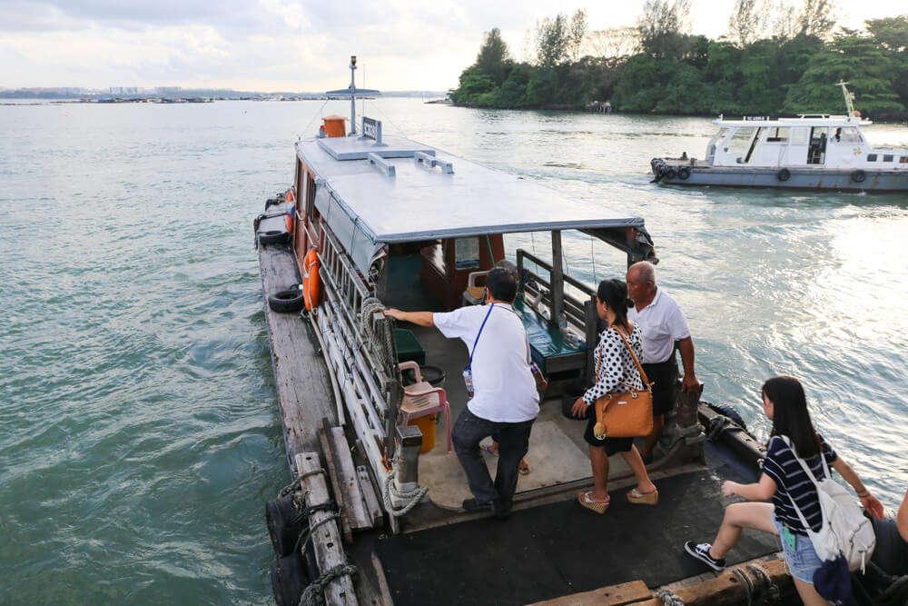 a boat on the waters in Pulau Ubin