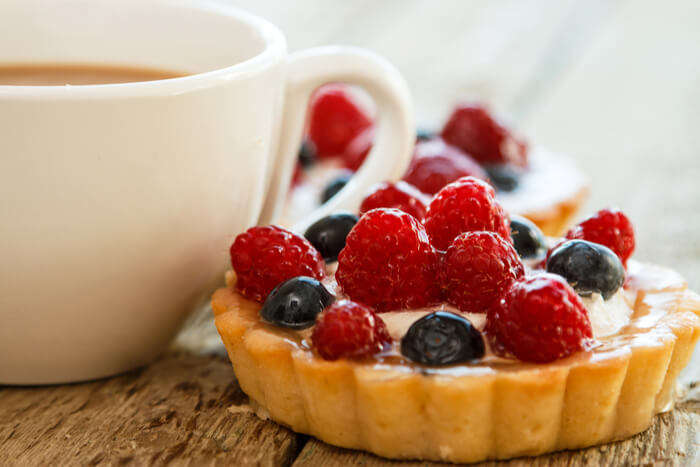 cup of coffee and sweet tart