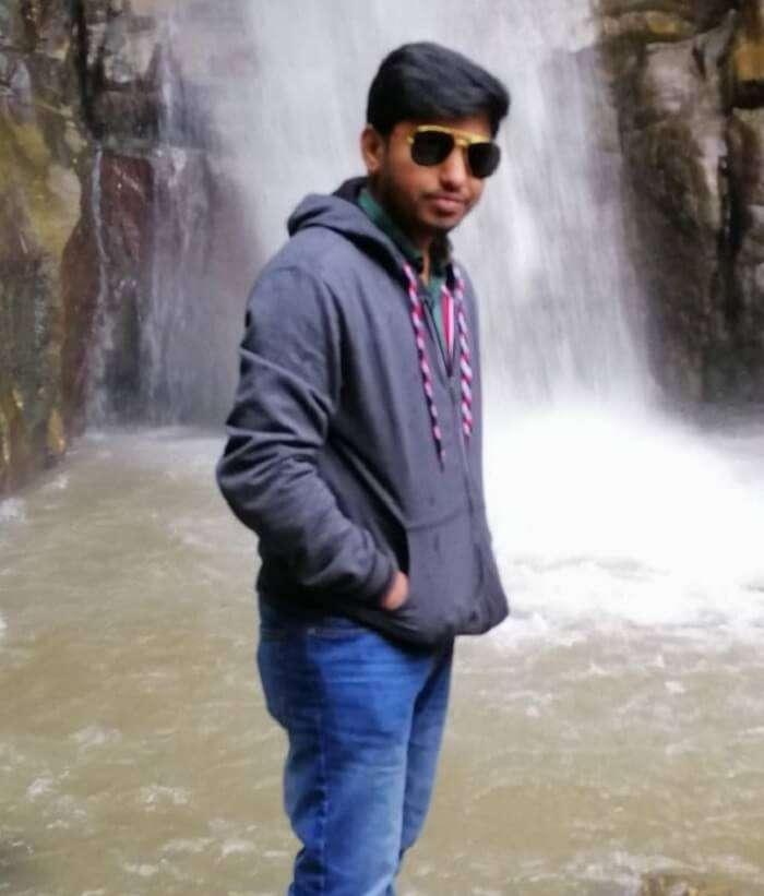 standing in front of waterfall