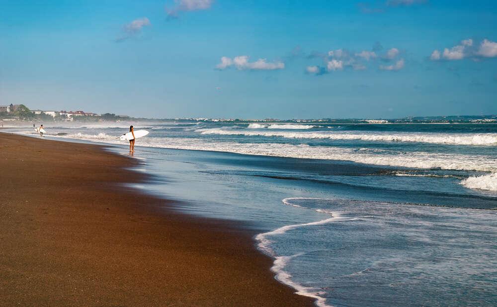 A girl surfing in beach