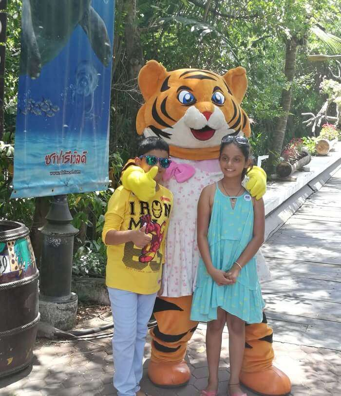 Children with toy tiger
