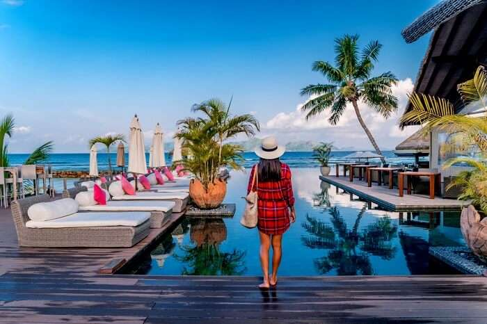 A girl standing at a resort