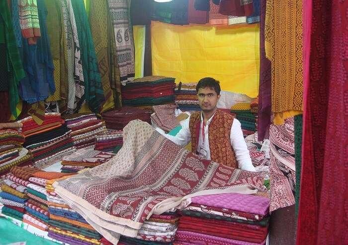 guy selling shawl