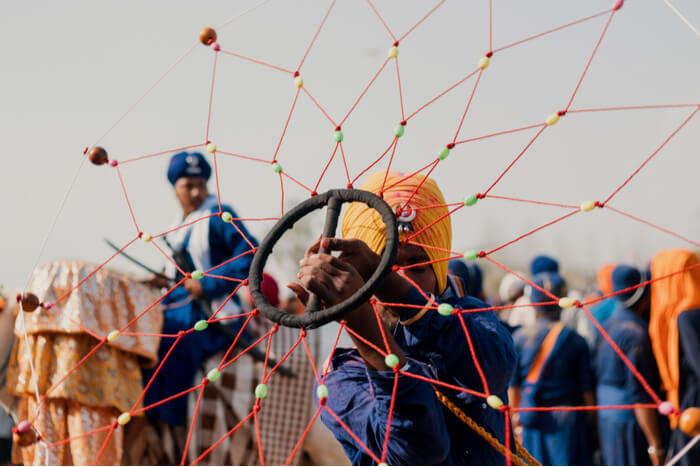 A man performing Punjabi folk dance