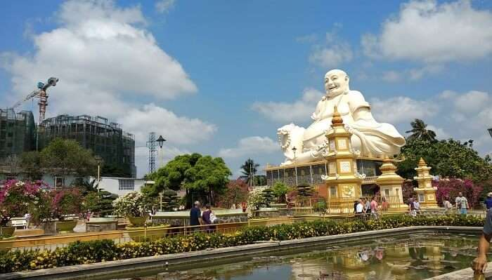 White Laughing Buddha statue in Vietnam