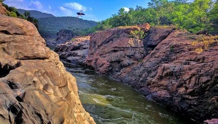 river running between rocky mountains