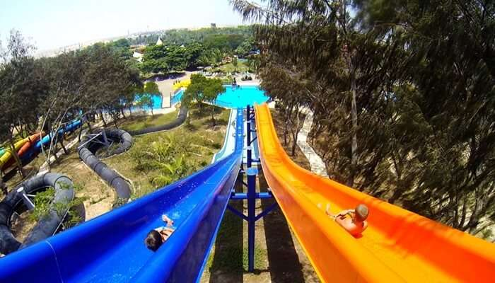 kids sliding down the water ride