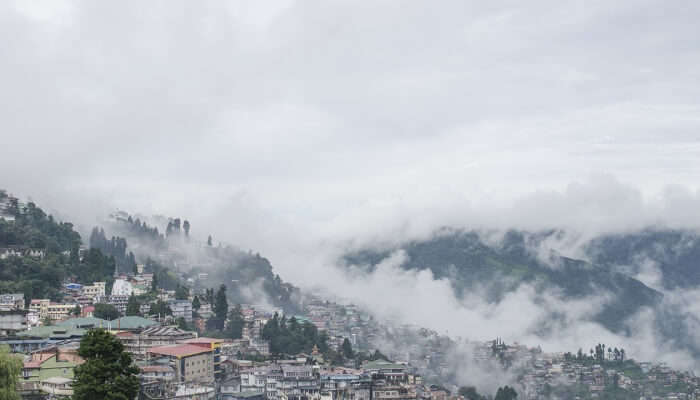 mountains and city covered in clouds