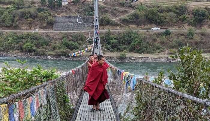 monks on the suspension bridge