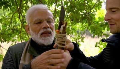 narendra modi and bear grylls holding a spear