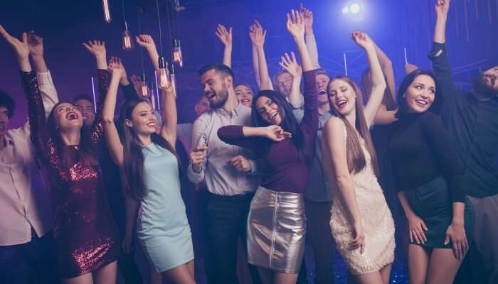 group of people dancing at a club