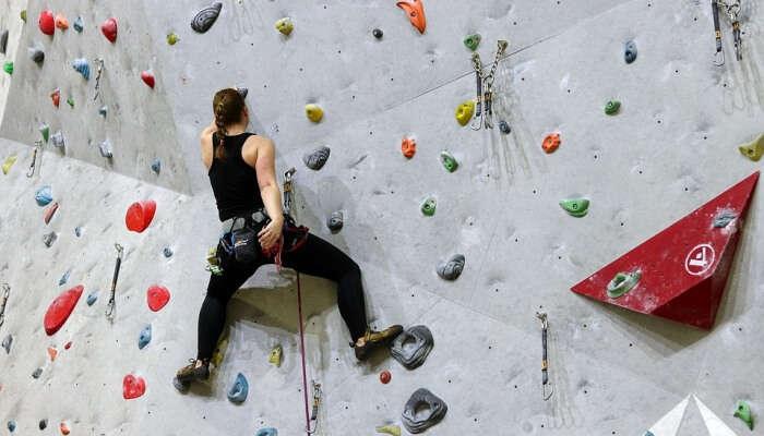 Woman taking part in indoor bouldering