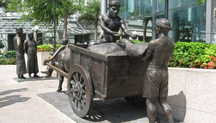 sculpture of laborers and merchants