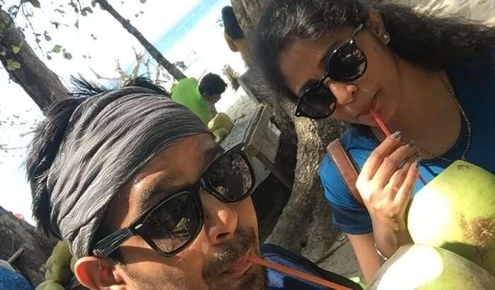 enjoying the coconut water