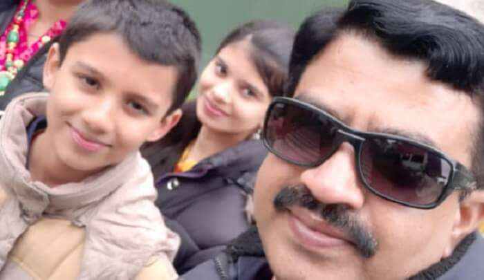 Dineshwar took pictures with his kids