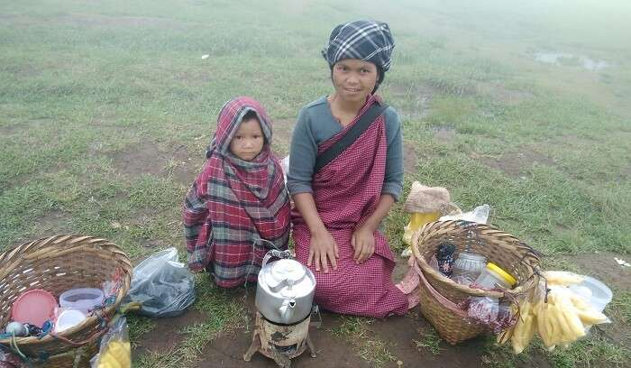 mother and child serving hot tea and snacks