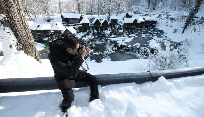 photographer capturing snowfall