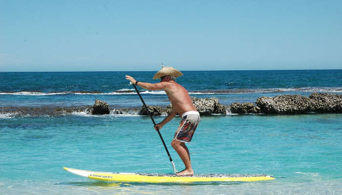 man doing standup paddle boarding